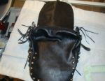 Leather backpack with rivets