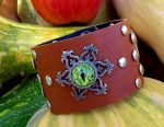 Leather wide bracelet with the eye of the crocodile