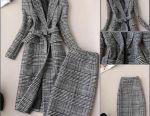 Knitted suit, jacket and skirt.