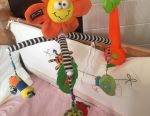 Musical mobile for a bed