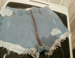 Denim shorts with zipper. Fashionable.