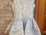 Blue cotton dress with a standing skirt