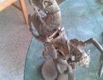 Bronze statue of a warrior .