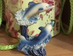 Figurine of dolphins