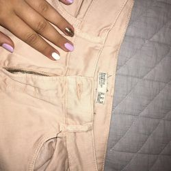 Pink jeans with holes