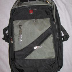 New backpack with a raincoat with a laptop compartment