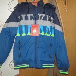 Курточка двухсторонняя новая на 5 – 7 лет.