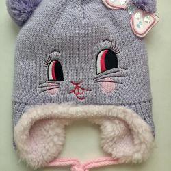 шапки нові
