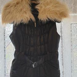 Vest. The fur comes unfastened.