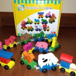 Ξύλινο τραίνο με νέα ζώα