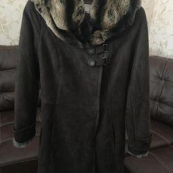Sheepskin coat is light, natural.