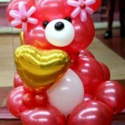 Bear with a heart of beads