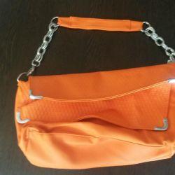 Τσάντα συμπλέκτη φωτεινό χρώμα καρότο