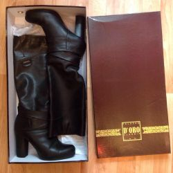 European winter boots. Natural fur and leather