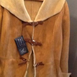 New natural sheepskin coat