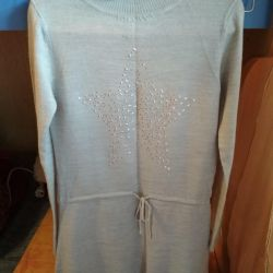 The dress is knitted, for height is 128-134.