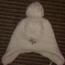 Winter hat for a girl of 7-10 years old