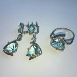 Silver. Earring and ring