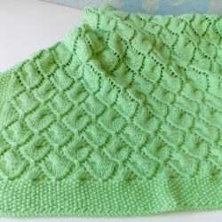 Plaid children's knitted Leaf. Manual knitting.