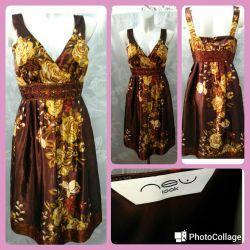 Νέο Κομψό νέο φόρεμα από το NEU LOOK