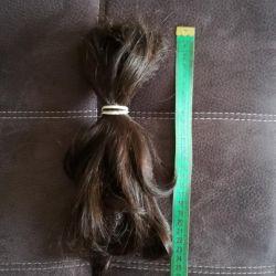 O grămadă de păr gros de 25 cm.