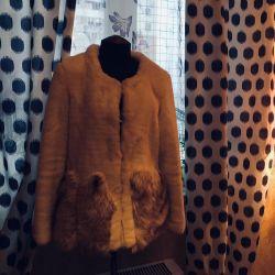 The fur coat is an artificial wedding, evening. S-m