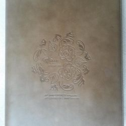 The folder is new, in the package, leatherette