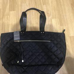 Bir kadın Utiliti çantası satacağım.