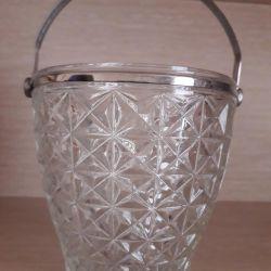Sugar bucket with a handle.