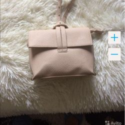 The bag is light beige