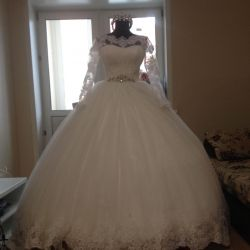 Magnificent wedding dress with a long train