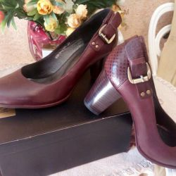 Shoes are leather, new, 38-39 size.