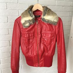 Jacket under a varnish with natural fur