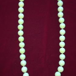 Beads from natural apple turquoise