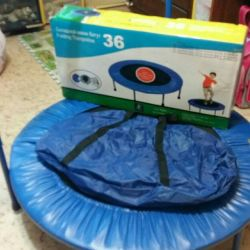 Children's folding trampoline with handle