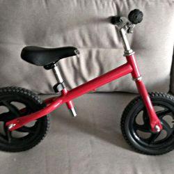 Red children's runbike