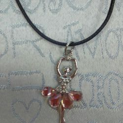Pendant Ballerina in a velvet bag.
