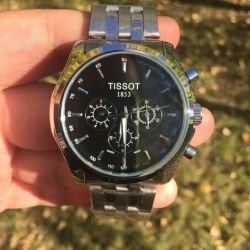Men's mechanical watch TISSOT with automobile.