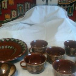 6 cups with a confectionery and a dish