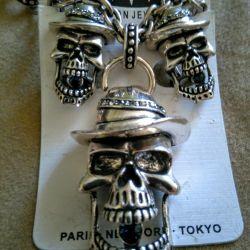 Three skulls with stones. Set of 4 items
