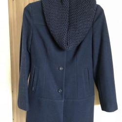 Coat female demi. With knitted yoke