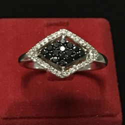 White gold ring with black diamonds