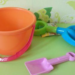 Children's bucket, shovels, watering cans
