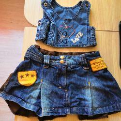 Top and branded denim skirt