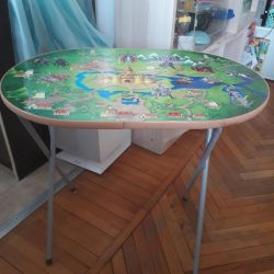 The table is children's, folding. With a stool