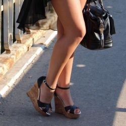 Stylish sandals on the rock