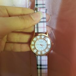 New women's pink watch in a cage brand chanel