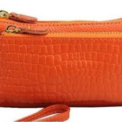 New, in packing, a purse from genuine leather