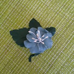 Brooch made of genuine leather.
