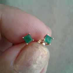 Gold studs with emerald.